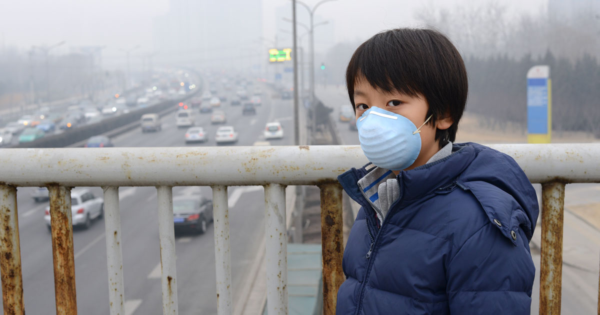 Air pollution with boy wearing face mask