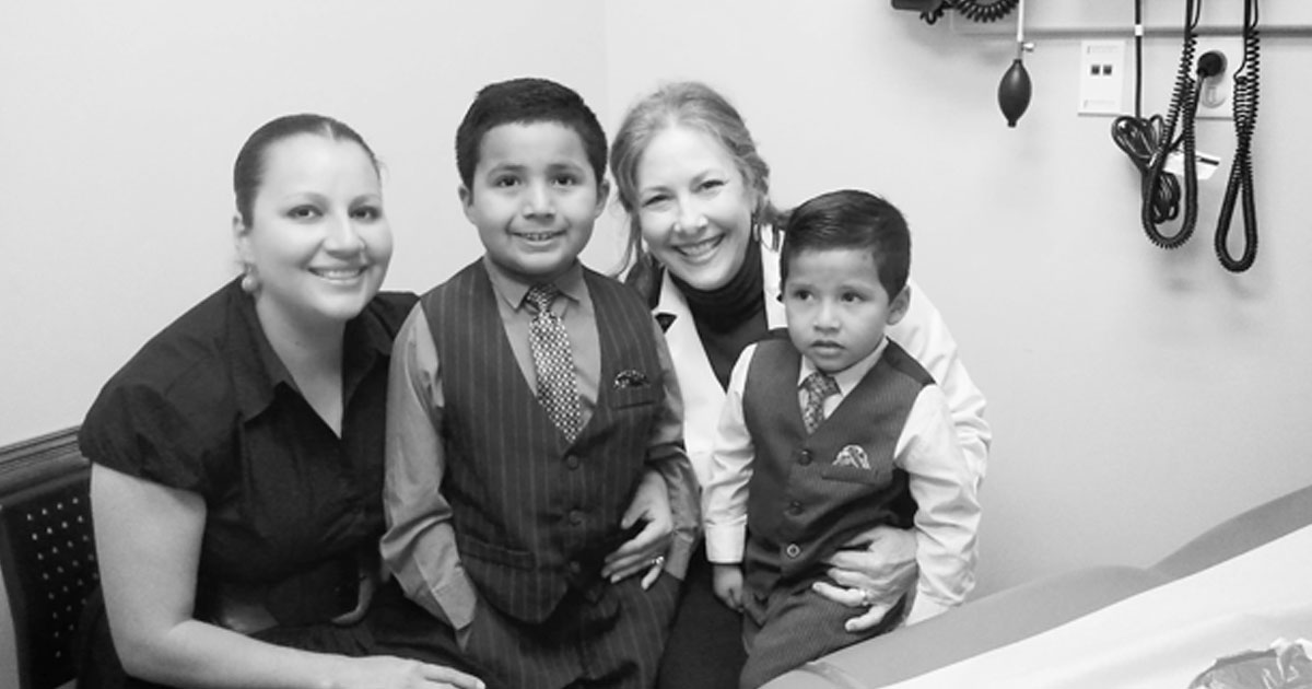 Marsha Griffin, MD with her patients, a mother and two children