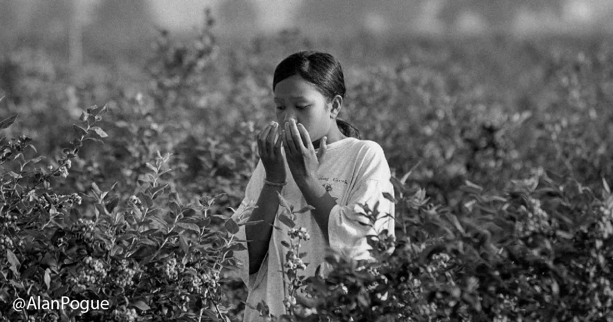 Farmworker girl coughs into hands