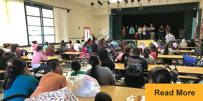 Immigrant families in Ventura County listen during a community meeting