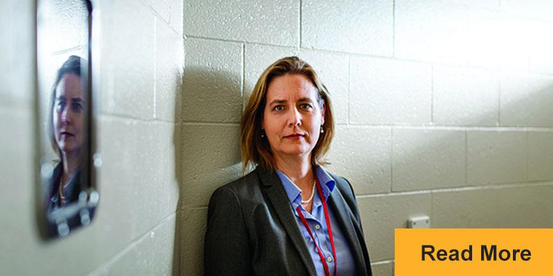 Jennifer Clarke standing in holding cell