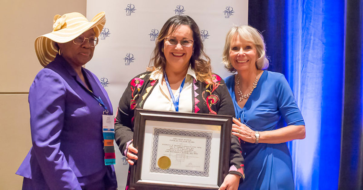 Patricia M. Juarez-Carillo receiving award