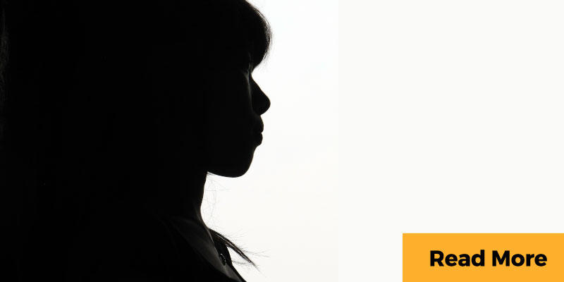Silhouette of pensive woman