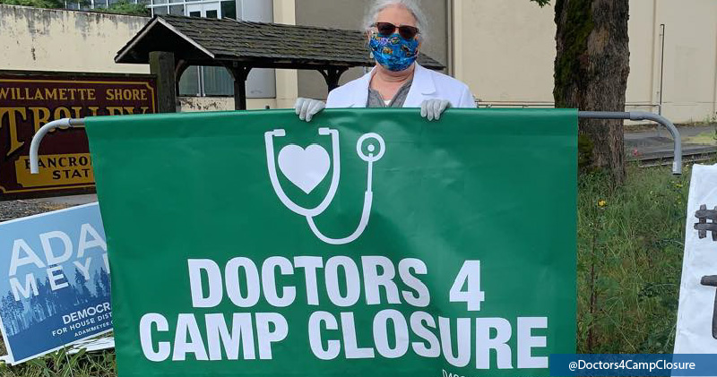 A clinician protests against conditions in migrant detention