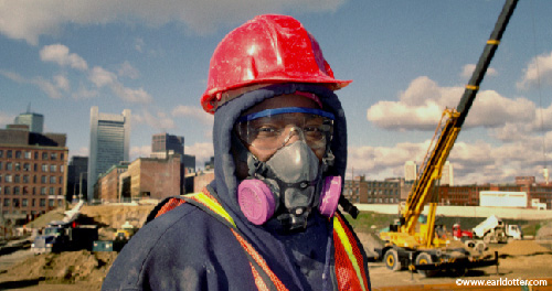 A construction worker wearing protective equipment