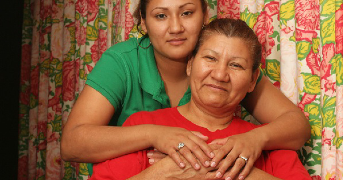 Woman has arms around her mother