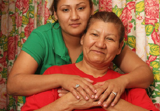 Woman has hands around her mother