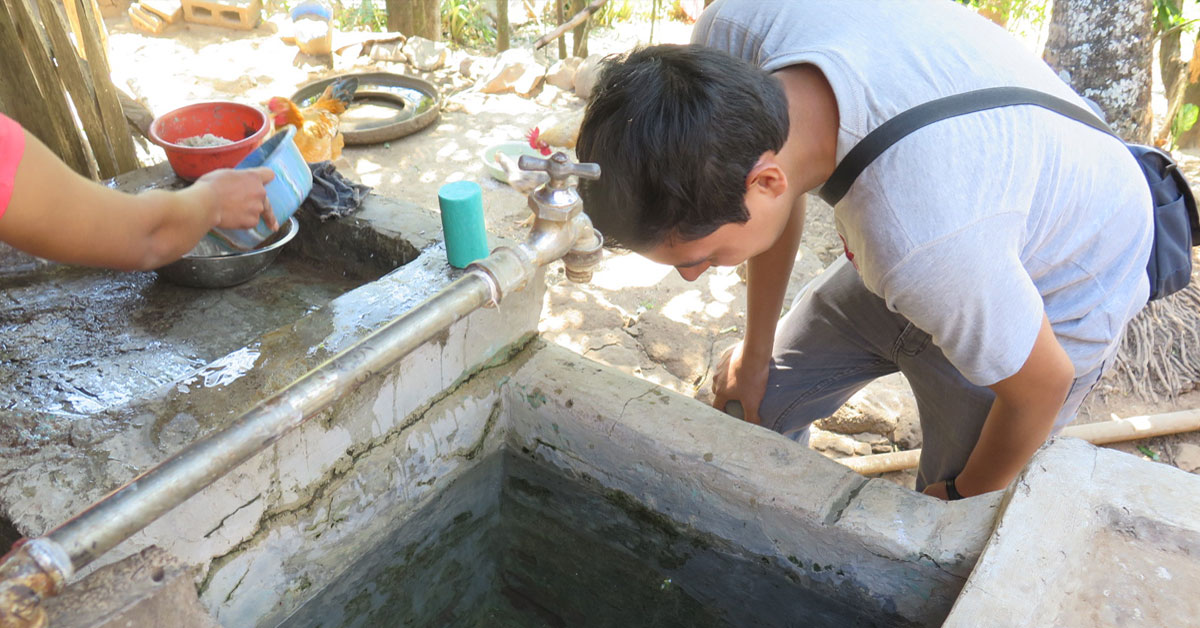 clinician inspects water source