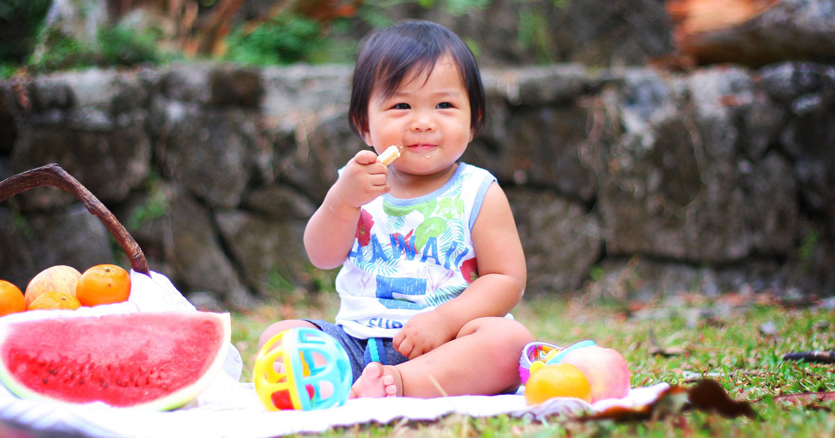 child eating food at a picnic