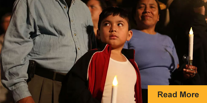 child holding candle looking nervous