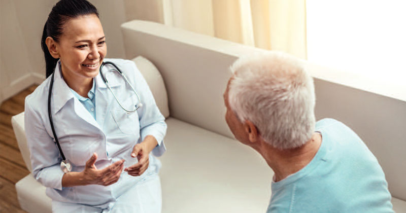 clinician talking to patient