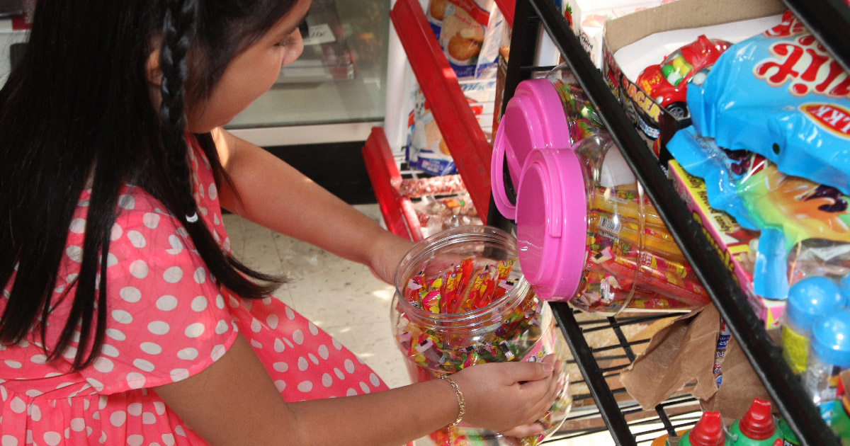 girl buying candy
