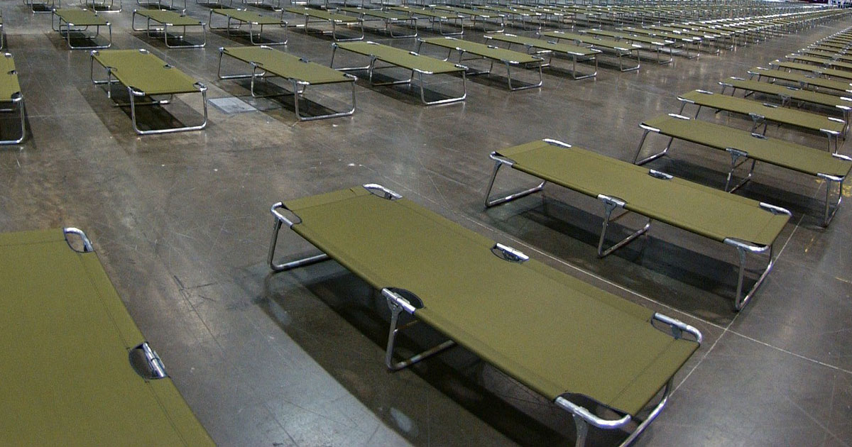 hundreds of empty cots