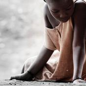 sick girl sitting on ground