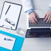 physician at computer