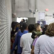 People waiting in line at detention center