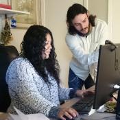 Health Network's Alma Colmenero and Robert Corona discuss a case in the office