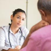 Clinician talks with patient