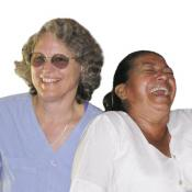 Candace Kugel laughs with a storekeeper in Honduras