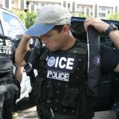 ICE agent putting on gear