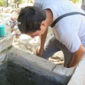 Clinician inspecting water source