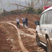 Cars driving on hurricane beaten dirt roads