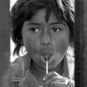 Girl looks through border fence