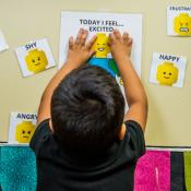 Child choosing faces that represent emotions