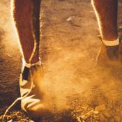 worker standing on dusty soil