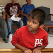 young boy and farmworkers in waiting room
