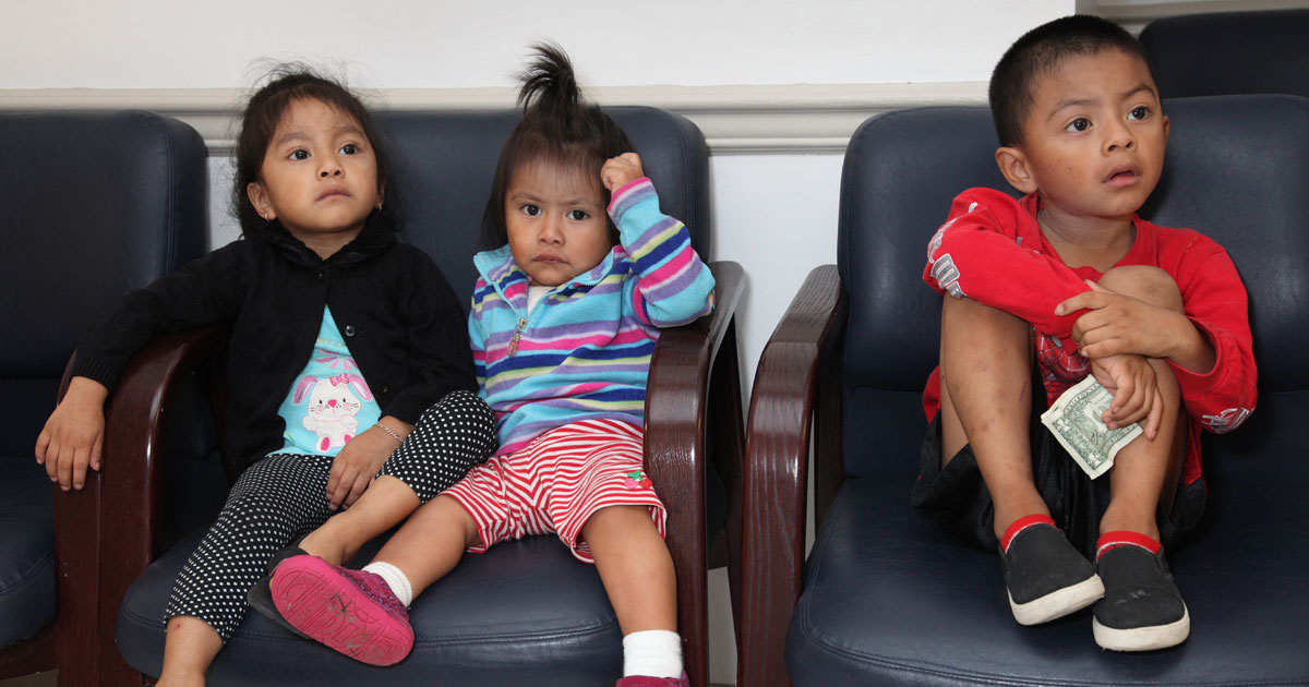 kids sitting in waiting room