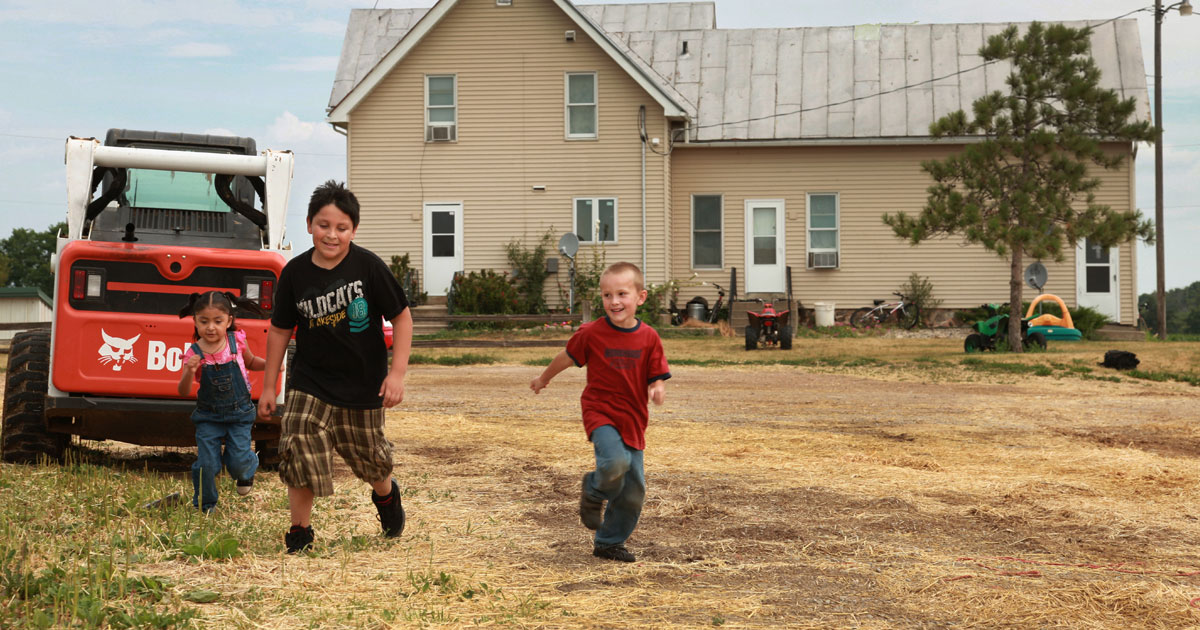 kids playing outside at a farm