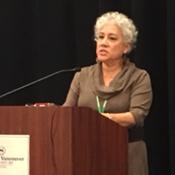 MCNs Deliana Garcia speaking at podium
