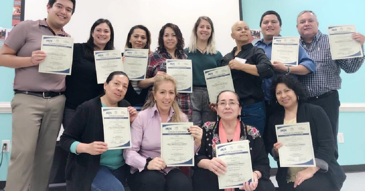 Training attendees pose with certificates