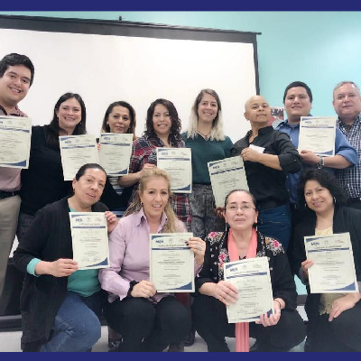 Training of Trainers attendees pose for photo with their certificates.