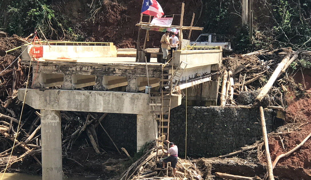 Hurricane Maria wiped away this bridge, completely cutting off a small community nestled in the mountains of Puerto Rico.