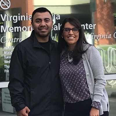 Kevin Alfaro-Martinez and Eva Galvez stand in front of health center.