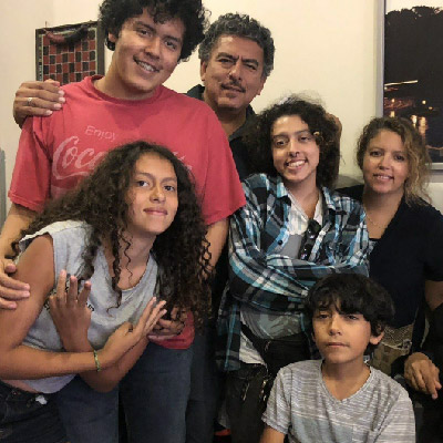 The Rodriguez family. Front row: Liliana, 13, and Alejandro, 10. Back row: Adria