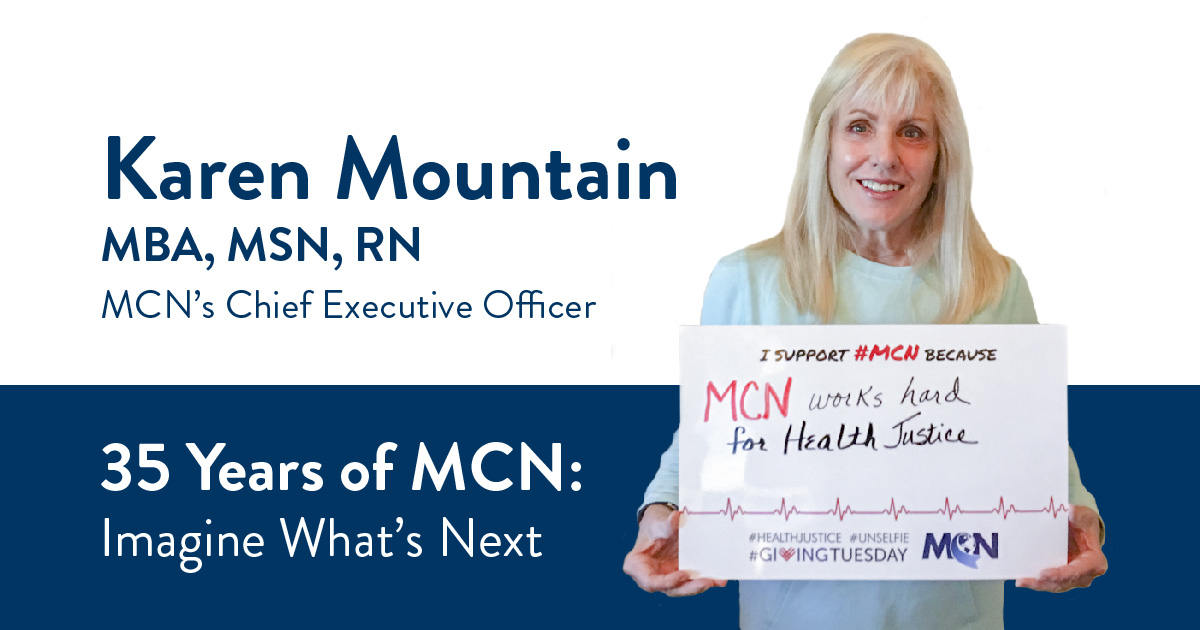 MCN CEO Karen Mountain holding an unselfie sign for giving tuesday