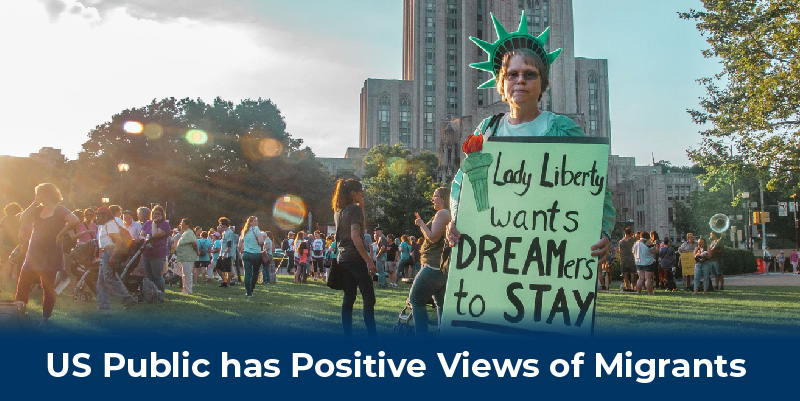 A woman with a sign that reads 'Lady Liberty wants Dreamers to stay'.