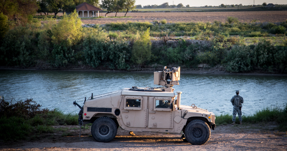 A member of the National Guard watches a portion of the Rio Grande river