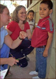 Candace Kugel visits with a child in Honduras