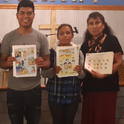 Photo of Farmworker parents after participating in a talk with a CHW