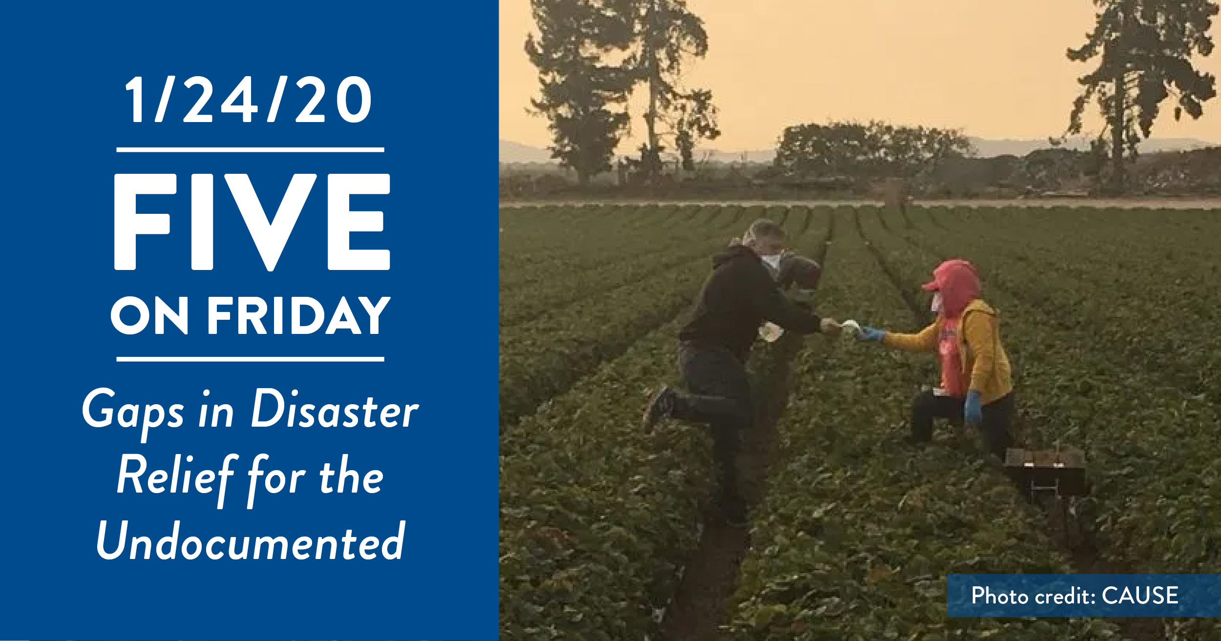 A farmworker hands another worker an N95 mask for the smoke