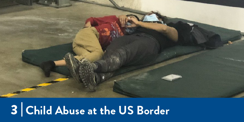 A mother and child lay in a detention center