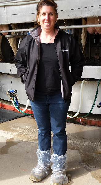 Amy wearing protective shoe covers while visiting a dairy farm