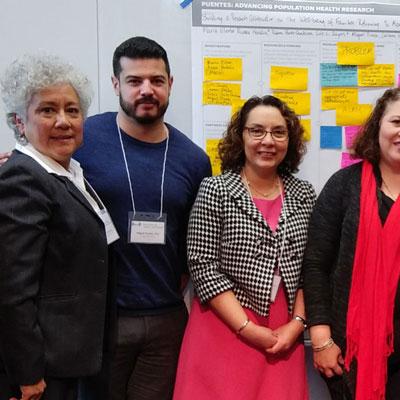 Deliana Garcia standing next to migrant health team
