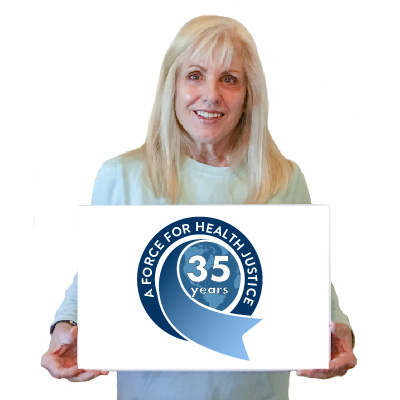 MCN's CEO Karen Mountain holding a 35 year anniversary sign