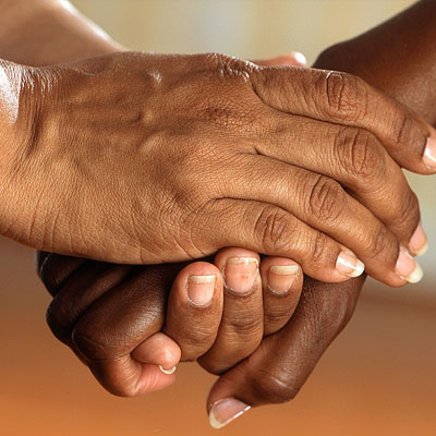 Woman holding hand comforting