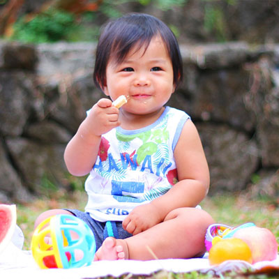 child eating food at picnic